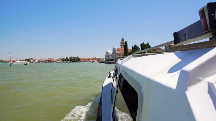 Tourist water bus moving towards Venice church, sightseeing tour for travellers | Shutterstock HD Video #23157799