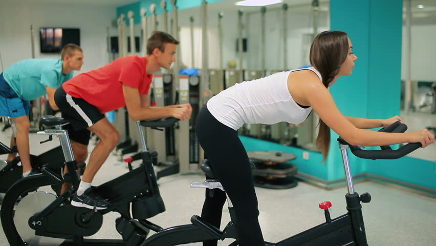 Young people doing sports exercises on the exercise bike in the gym | Shutterstock HD Video #23162047