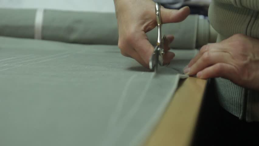Scissors cut grey fabric   Shutterstock HD Video #23175169