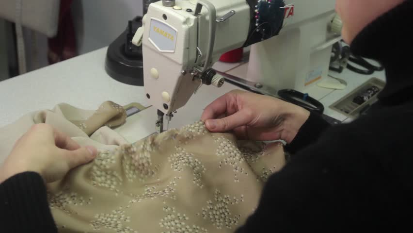 Hands seamstress hold the fabric while sewing   Shutterstock HD Video #23175178