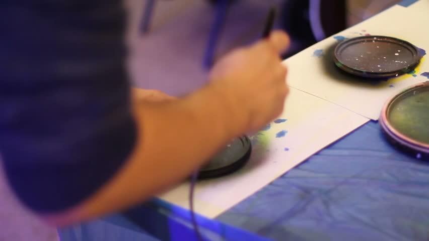 Spray art. painter draws a planet | Shutterstock HD Video #23179489