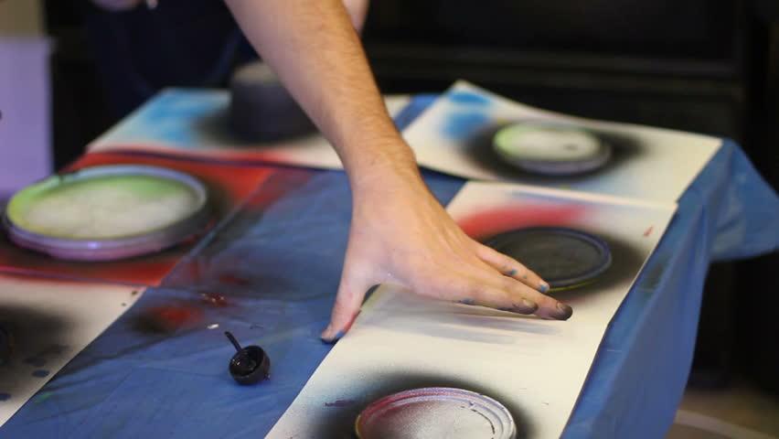 Spray art. painter draws a planets | Shutterstock HD Video #23179516