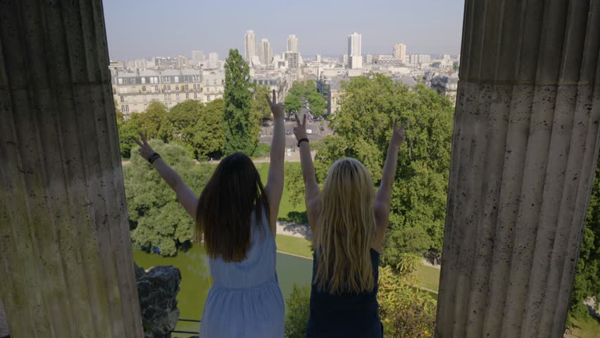 Happy Young Women Pose With Peace Signs At The Temple De La Sibylle In The Parc Des Butte Chaumont In Paris, France | Shutterstock HD Video #23180875