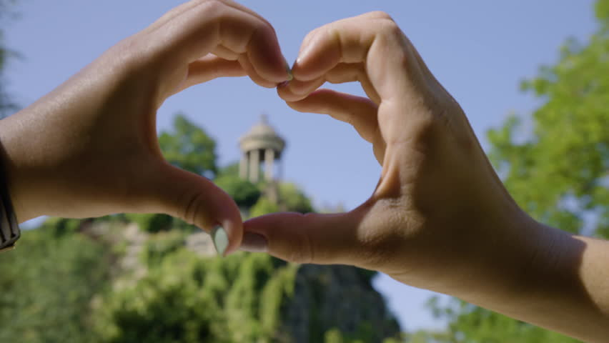 Young Women Create A Heart Shape Around The Temple De La Sibylle In The Parc Des Butte Chaumont In Paris, France | Shutterstock HD Video #23180893