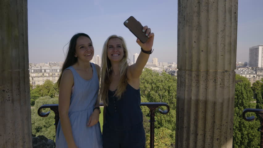 Young Women Pose For Fun Selfies In The The Temple De La Sibylle In The Parc Des Butte Chaumont In Paris, France | Shutterstock HD Video #23180902