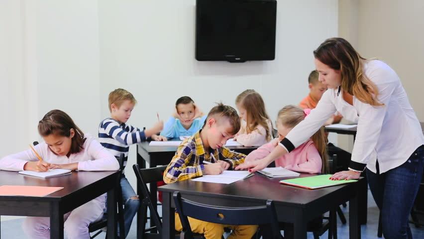 Children of elementary age having class of art   | Shutterstock HD Video #23188894