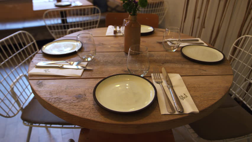 Zoom out shot of an empty table at a fashionable restaurant   Shutterstock HD Video #23190001