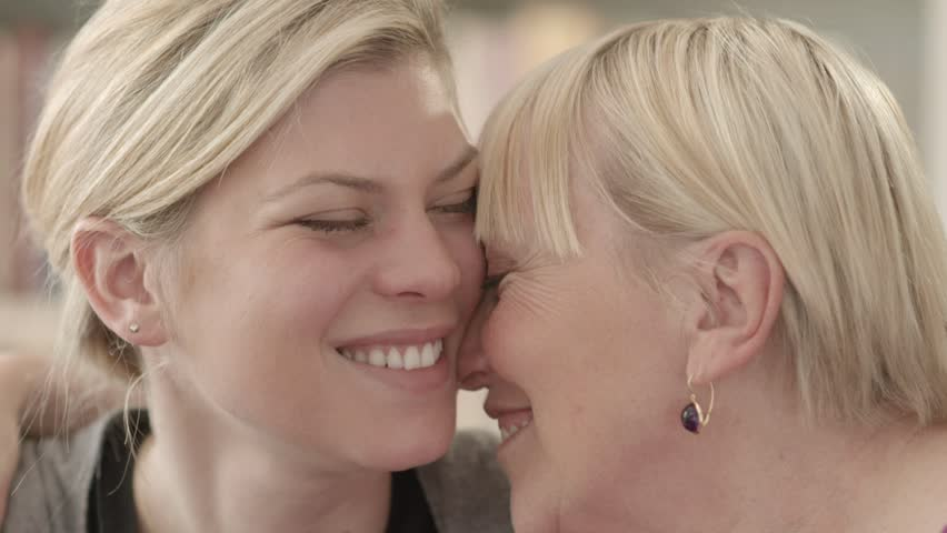 People, women, girl, family portrait of happy mother and daughter smiling, hugging, showing love and affection. Close-up, slow motion