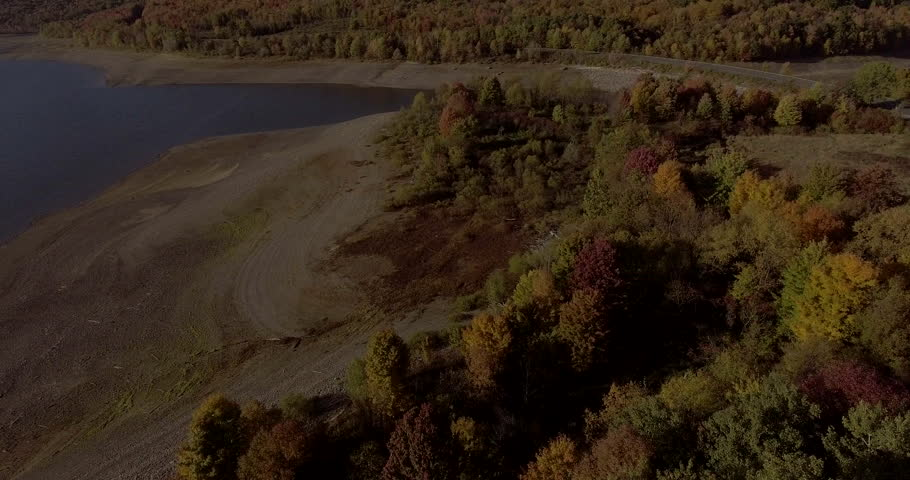 Aerial view of the fall foliage surrounding Cannonsville Reservoir in upstate New York.   Shutterstock HD Video #23207965