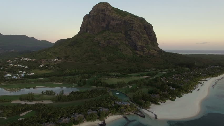 Aerial view of Le Morne Brabant peninsula with mountain, lagoon and white sand beaches. Mauritius Island   Shutterstock HD Video #23211484