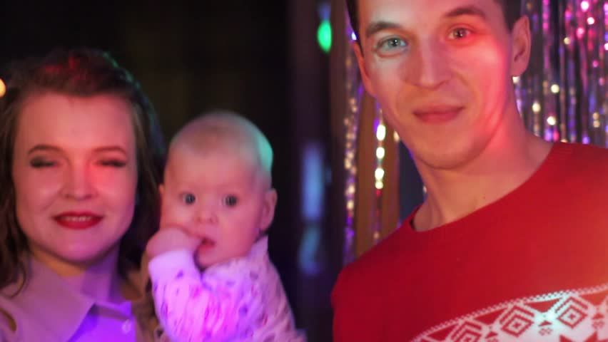 Happy young couple celebrating Christmas with a child. | Shutterstock HD Video #23212951