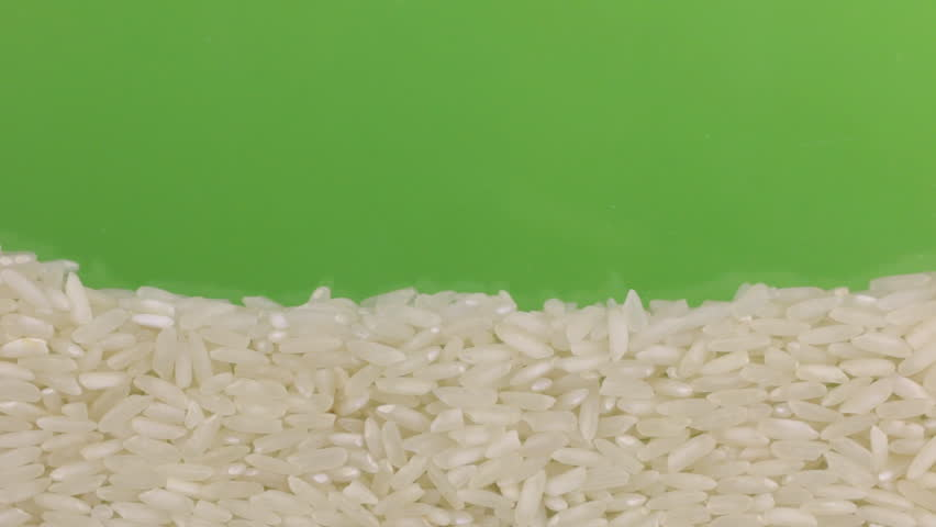 Rice grains close the (to bury) green screen. | Shutterstock HD Video #23213248