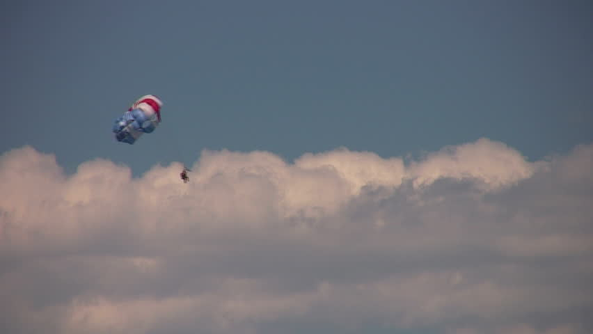 Parasailing in the clouds above Lake Tahoe - HD stock video clip