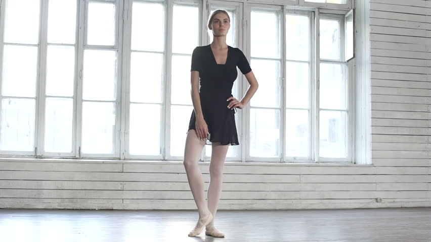 Ballet dancer raises a leg up in ballet class | Shutterstock HD Video #23228125