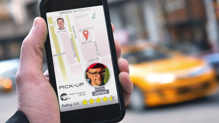 A man uses a ride-sharing app on his cellular phone to call a driver.   | Shutterstock HD Video #23324065