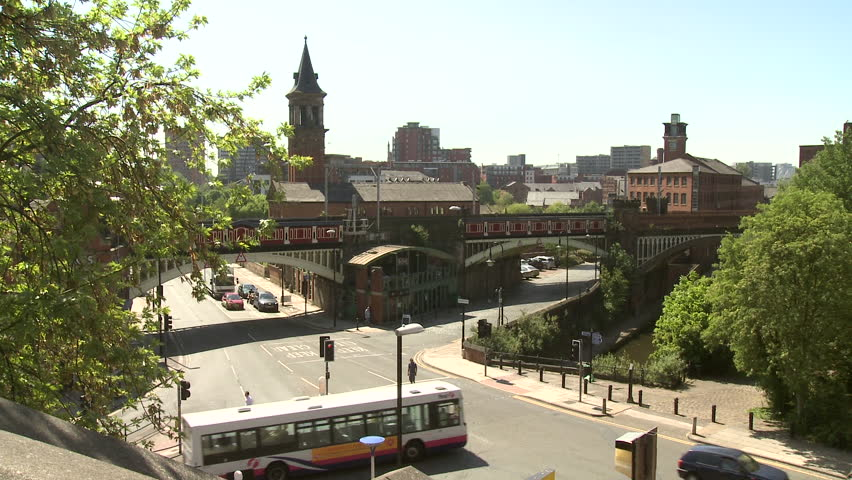 MANCHESTER - MAY 25: Timelapse of Deansgate road with railway tracks, pedestrians and cars on May 25, 2012 in Manchester, England.