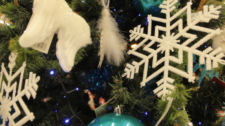 Christmas tree with white toys and decorations background. Close-up. In the hypermarket. #23435269