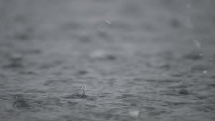 A closeup shot of heavy rain on water. Good sound!