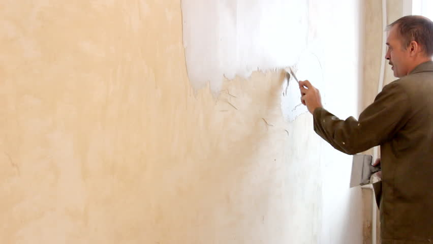Man plastering wall with spatula. | Shutterstock HD Video #23515288