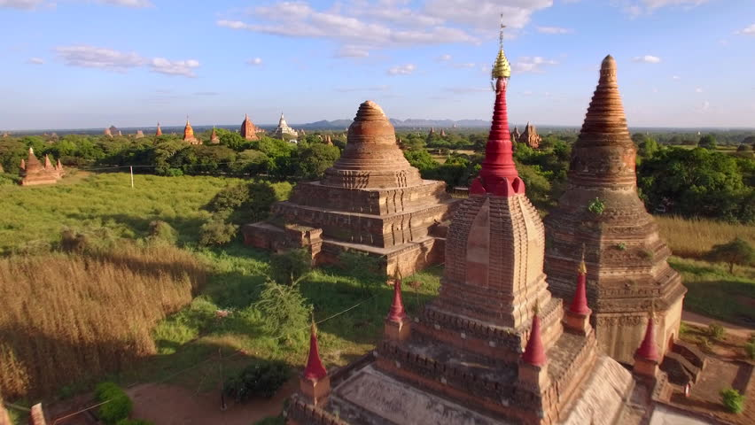 Bagan, Myanmar (Burma), aerial view of ancient temples and pagodas at sunset. | Shutterstock HD Video #23519509