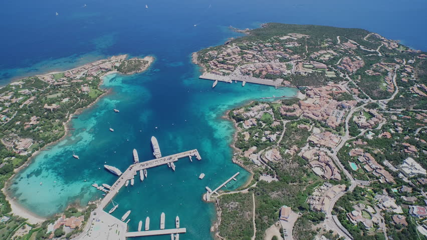 Mediterranean bay from drone Drone shot from extreme high position above a bay with shallow water and sail harbor, small town. | Shutterstock HD Video #23535502