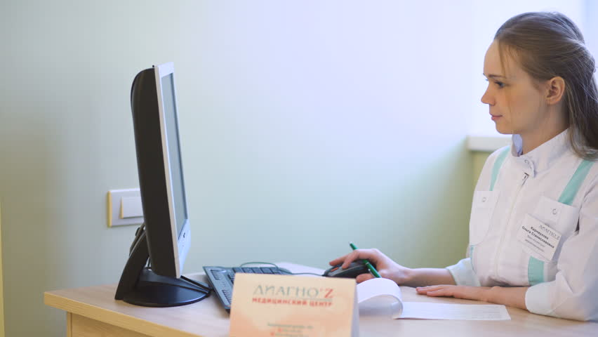 Female doctor wors at computer in medical center | Shutterstock HD Video #23808157