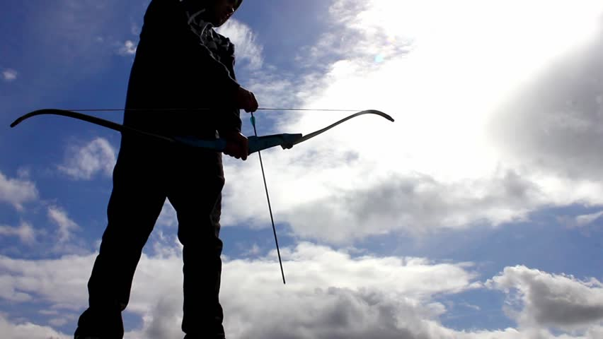 Silhouette of man using bow and arrow   Shutterstock HD Video #23832781