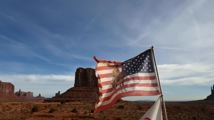 USA flag waving in front of the special mountain monument, in monument valley, Utah and Arizona border, United states of America | Shutterstock HD Video #23954866