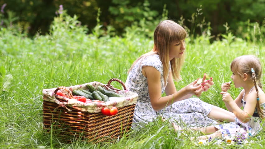 Mother and daughter with vegetables outdoors  - HD stock footage clip