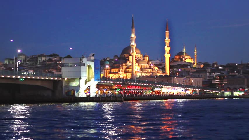 An Istanbul night in blue. Galata Bridge and Mosques at Night.