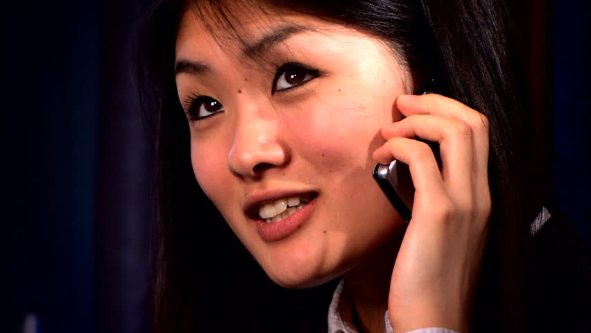 Portrait of an elegant japanese business woman on a mobile phone | Shutterstock HD Video #240748