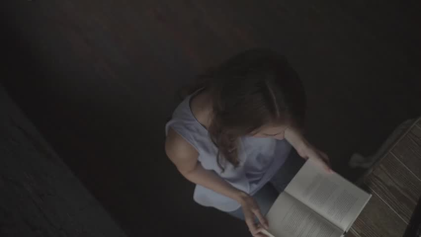 Guy hugging a girl which reads a book. | Shutterstock HD Video #24102673