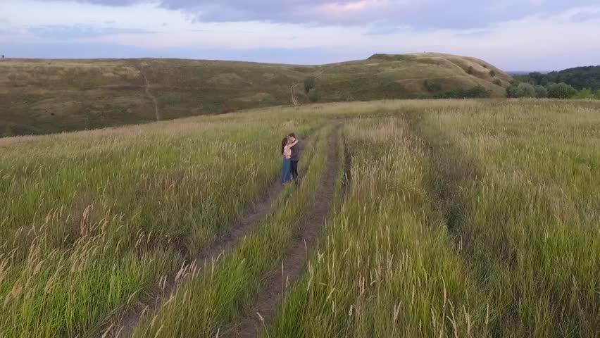 Couple walking in a field. | Shutterstock HD Video #24102691