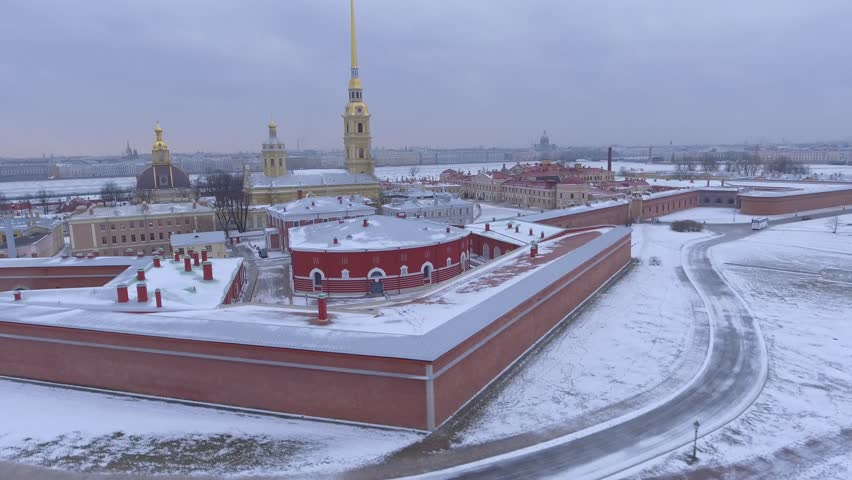 Winter morning flight over Peter and Paul Fortress Petropavlovskaya Krepost citadel of St. Petersburg, Russia. Spire with angel. Dramatic mood. Unique cinematic 4k drone footage. Panorama. Aerial | Shutterstock HD Video #24106813