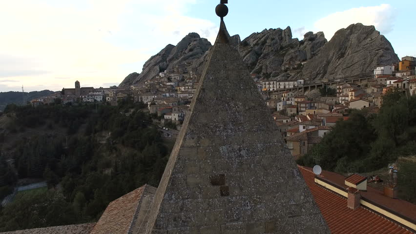 Cross on a steeple. A small town is visible in the distance. Italy, aerial drone video. About mountains, rocks, religion, nature, Catholicism, Christianity | Shutterstock HD Video #24107641