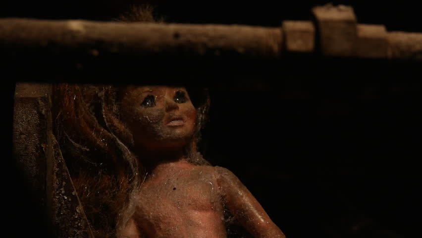 THE DOLL OF YOUR NIGHTMARES.   SLOW DOLLY MOVE REVEALS A VINTAGE GIRL DOLL, COVERED IN DUST & COBWEBS, SITTING ON TOP OF A RUSTY INDUSTRIAL BOILER. | Shutterstock HD Video #24115705