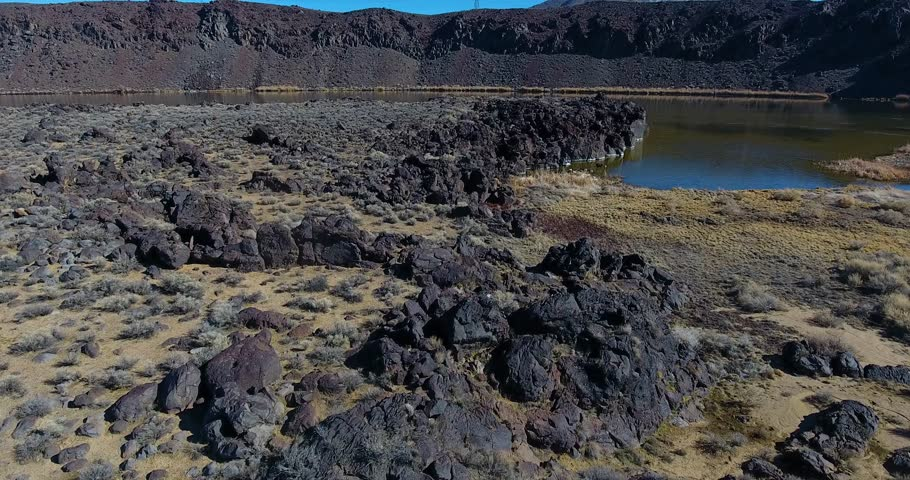 Aerial Drone Flyover of Reflecting Volcanic Lake 4k 24fps  | Shutterstock HD Video #24115975