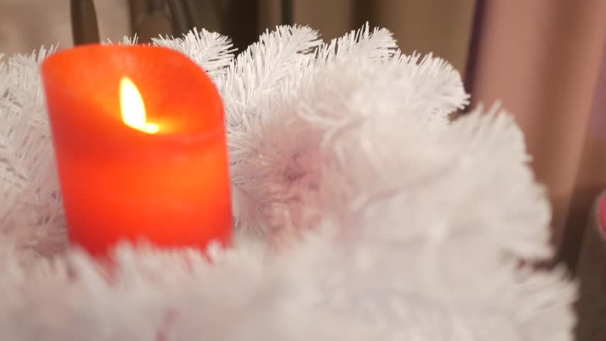 Christmas wreath and burning candle. Close up handheld shot | Shutterstock HD Video #24117496