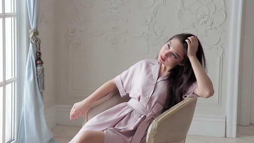 Romantic asian fashion model posing sitting on chair in studio interior   Shutterstock HD Video #24122680