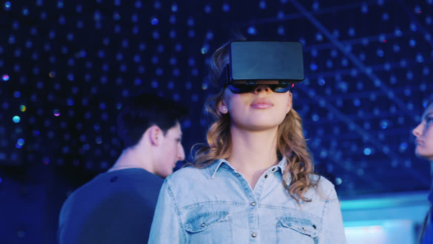 New technologies. Woman in helmet virtual reality dancing in a nightclub | Shutterstock HD Video #24131509