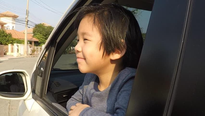 Happy Asian boy travels by car, slow motion   Shutterstock HD Video #24133165