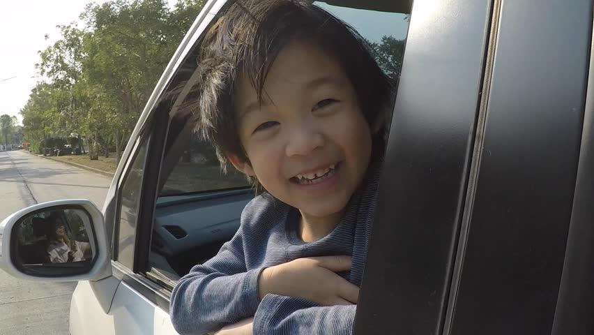 Happy Asian boy travels by car, slow motion   Shutterstock HD Video #24133174