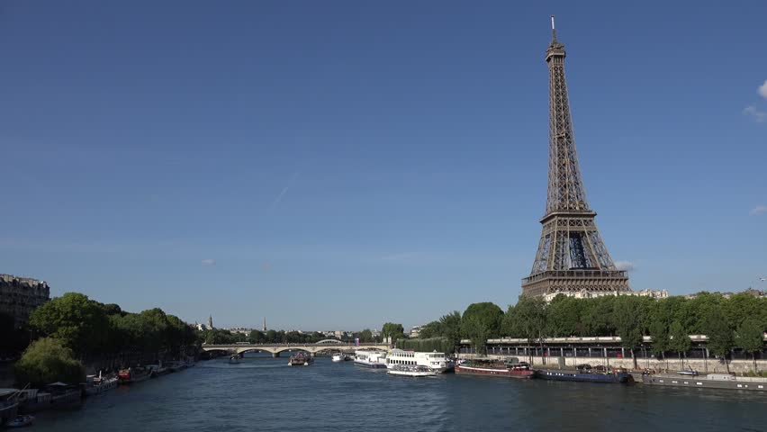 4K Eiffel Tower in Paris by Day, Traffic Tourboat with Tourists on Seine   Shutterstock HD Video #24186832