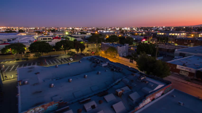 4K Aerolapse ( aerial timelapse / hyperlapse ) of the industrial area in Downtown Los Angeles at dusk. | Shutterstock HD Video #24215020