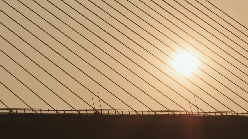 Steel cables of the bridge against the sunset. Bridge in Ha Long city. | Shutterstock HD Video #24226153