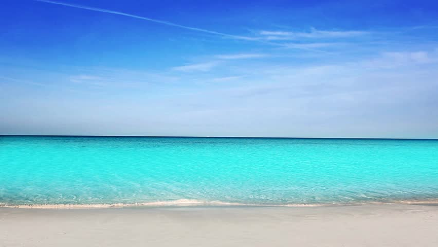 Balearic Ibiza Formentera turquoise beach with white sand and blue summer sky - HD stock video clip