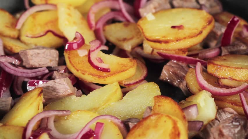 Grostl (typical Tirolean dish using leftovers) in a pan - HD stock footage clip