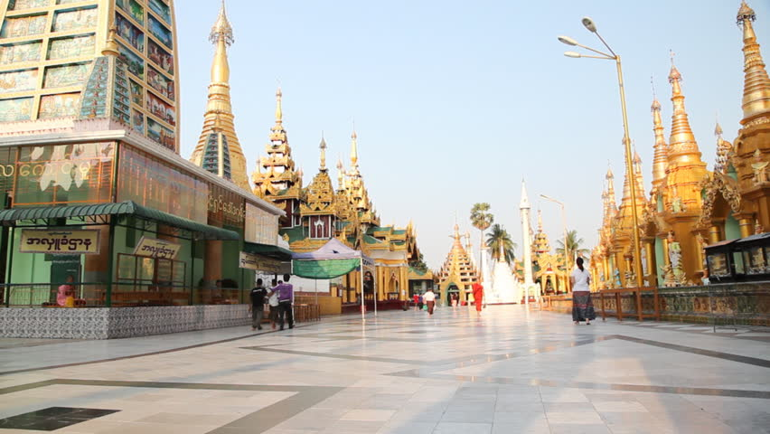 YANGON, MYANMAR- APRIL 15 : Tourists visit the Shwedagon Pagoda in Bagan on April 15, 2012.  Bagan is most popular place for visit in Myanmar