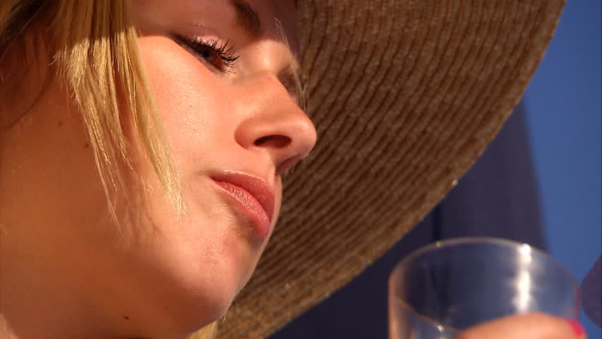 Beautiful blonde girl with champagne & strawberries aboard a yacht - HD stock footage clip
