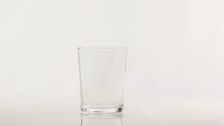 clear water pours from a plastic bottle into a glass - HD stock video clip